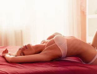 Photo of a girl lying down in lingerie on the bed
