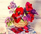 Beautiful spring bouquet of flowers. Unusual retro color toning