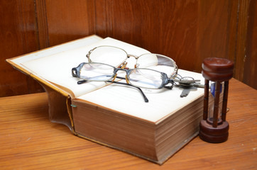 Old book memorize time on wood table