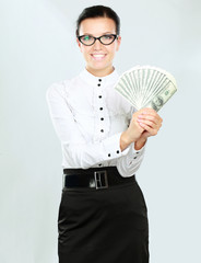 Young happy woman with dollar notes in both hands.