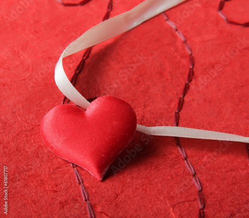 Heart , isolated on red background.