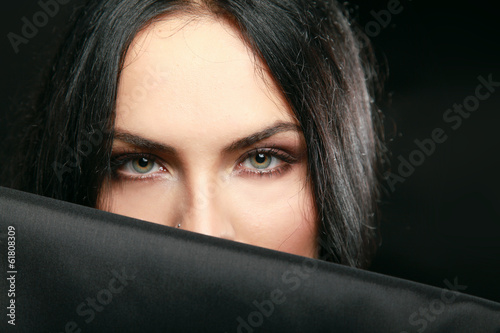 Portrait of a beautiful woman , isolated on black background.