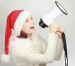 girl in santa hat with a megaphone