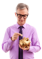 Business man putting coin into piggy bank
