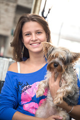 Smiling teen girl with her pet