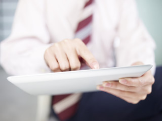 business person using tablet computer