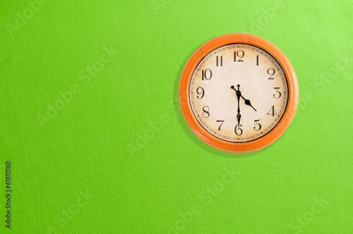Leinwanddruck Bild Clock showing 04:30 on a green wall