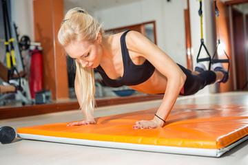 fit woman doing push-ups