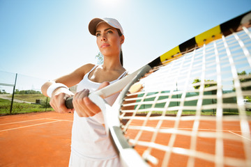 tennis player with racquet expecting a ball