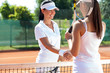 female tennis players shaking hand