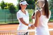 female tennis players shaking hand
