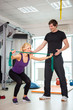woman exercising with personal trainer