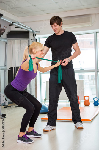 Woman exercising  with rubber bands
