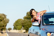 Woman on car roadtrip enjoying freedom