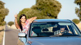 Couple enjoy freedom on car travel