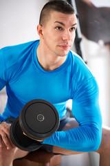 Sportman doing weights lifting