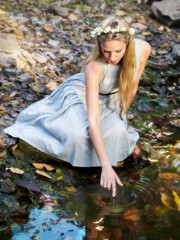 Beautiful Fairytale Princess Sitting By Water Pond
