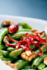 Green bean salad with walnuts and red peppers