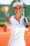 tennis player showing golden goblet