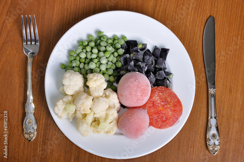 frozen tomato, asparagus, peas and cauliflower on a plate