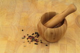 Wooden mortar and pestle with  pepper mix