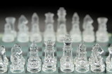 Glass chess on black background