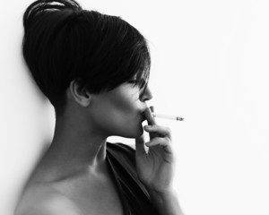 Close-up portrait in profile of a girl with a cigarette
