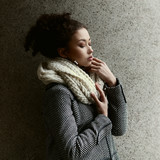 Beautiful fashionable black girl posing in a winter coat