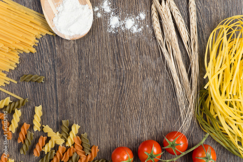 pasta, tomatoes and flour on the spoon