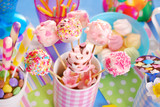 birthday party table with marshmallow pops and other sweets for