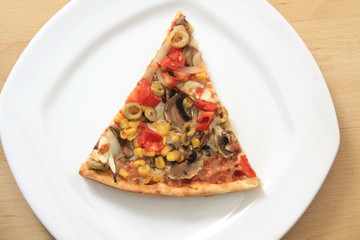 Vegetable pizza slice