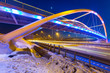 Foothpath bridge over bypass of Gdansk at night, Poland