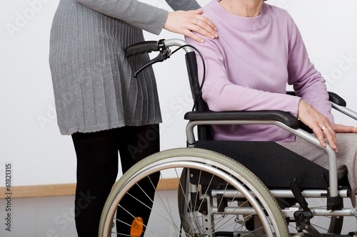 Daughter and her mom on wheelchair