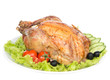 Garnished roasted thanksgiving chicken on a plate