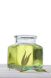 Eucalyptus oil and eucalyptus leaves with bottle in background