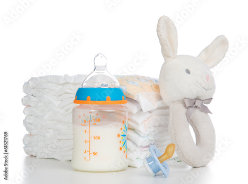 New born child stack of diapers, nipple soother, beanbag bunny