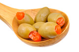 stuffed green olives and wooden spoon
