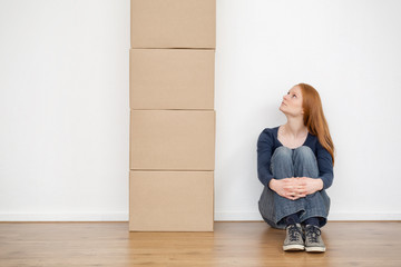 Woman Looking at Moving Boxes