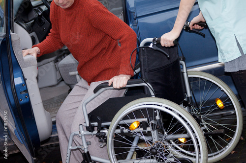 Nurse offering a wheelchair