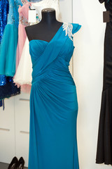 Beautiful turquoise gown on mannequin in a bridal shop