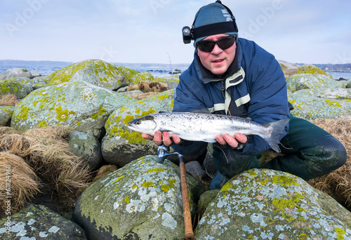 Men with silver sea trout trophy