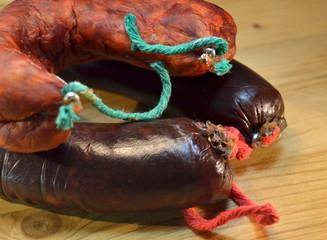 Spanish morcilla and chorizo , on wooden board