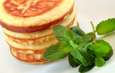 Pancakes with mint leaves