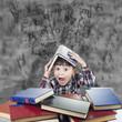 Niño con libros agobiado bajo una lluvia de letras