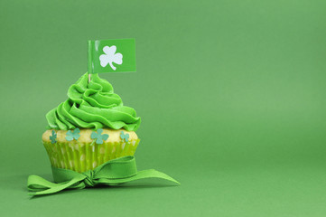 Happy St Patricks Day green cupcake with copy space