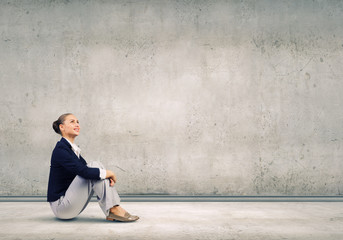 Businesswoman sitting on floor