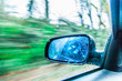 Car on the road rear view mirror motion blur background - 61827573