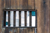 Small window wth bars on wooden door