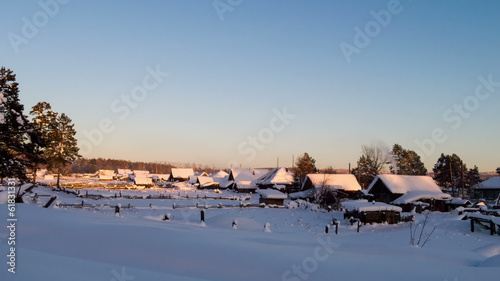 Houses under snow at sunset. Time Lapse