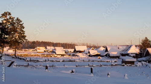 Winter village at sunse. Time Lapse